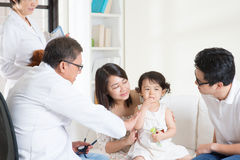 Pediatrician and patient Stock Image
