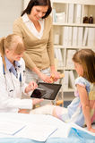 Pediatrician point at x-ray girl broken leg Royalty Free Stock Photo
