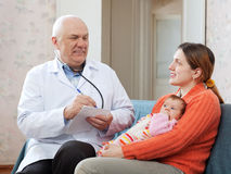 Pediatrician of prescribes to newborn baby medication Royalty Free Stock Photography