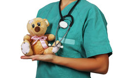 Pediatrician. With stethoscope and teddy bear Royalty Free Stock Images