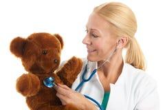 Pediatrician with stuffed bear Stock Photos