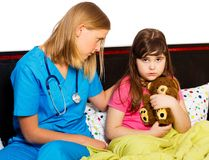 Pediatrician Supporting Sick Little Patient Stock Photos