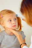 Pediatrician taking temperature Stock Images