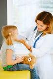 Pediatrician taking temperature Royalty Free Stock Image
