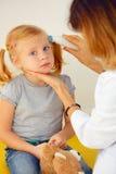 Pediatrician taking temperature Stock Image