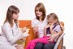 The pediatrician tells about medicine mom sick girl Royalty Free Stock Image