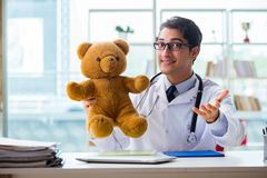 The pediatrician with toy sitting in the office Royalty Free Stock Photo