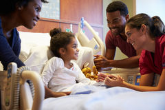 Pediatrician Visiting Parents And Child In Hospital Bed Stock Photography