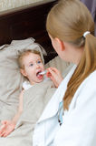 Pediatrician visiting sick child Royalty Free Stock Photography