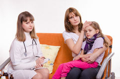 Pediatrician visits a sick child at home Royalty Free Stock Image
