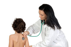 Pediatrician woman making a checkup for child Stock Photo