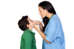 Pediatrician woman making a checkup for child Stock Images