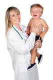Pediatrician woman with a scared baby Stock Image
