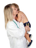Pediatrician woman with a scared baby Stock Photo
