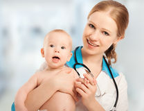 Pediatrician woman doctor holding patient baby Royalty Free Stock Photos