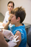 Pediatricians vaccinate a child Stock Photos