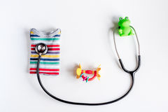 Pediatrics equipment with toys, stethoscope white background top view space for text Royalty Free Stock Image