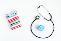 Pediatrics equipment with toys, stethoscope white background top view Royalty Free Stock Images