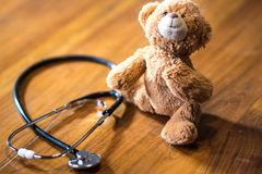 Pediatrics: stethoscope and toy bear royalty free stock photos