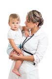 Pediatrist doctor holding baby on her hands Royalty Free Stock Image
