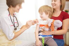 Pediatrist examinate young patient`s lungs with stethoscope. Pediatrist examinate young patient`s lungs with a stethoscope royalty free stock photo