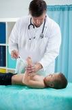 Pediatrist measure the temperature Royalty Free Stock Photo