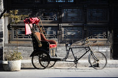 Pedicab in Houhai, Beijing. The pedicab takes tourist around the intricate winding hutongs to admire the old courtyards. They are maze-like and deep and exactly stock image