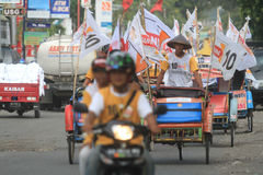 Pedicab parade when the party of democracy in Indonesia. Some paddle rickshaw participate in the democratic march, held one of the political parties royalty free stock photos