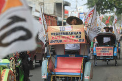 Pedicab parade when the party of democracy in Indonesia Stock Photo