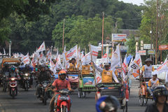 Pedicab parade when the party of democracy in Indonesia Stock Photos