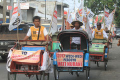 Pedicab parade when the party of democracy in Indonesia Royalty Free Stock Image