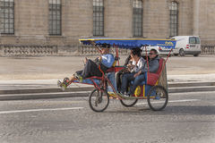 Pedicab in Paris, France. Used to sight see by tourists Royalty Free Stock Photography