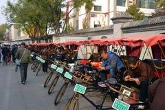 Pedicab riders wait for passengers Stock Image