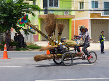 Pedicab selling brooms. Stock Photography
