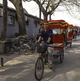 Pedicabs in Beijing. Beijing, China April 3, 2016 Pedicab drivers lined up waiting for fares in Beijing Royalty Free Stock Images