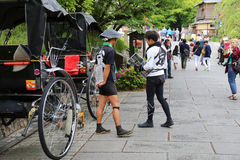 Pedicabs-guides on the streets of Kyoto Stock Photo