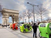 Pedicabs near Arc de Triomphe Paris Royalty Free Stock Photos