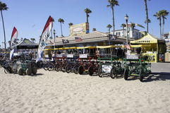 Pedicabs For Rent. A number of Pedicabs long lined for rent for people coming from different parts of the city and for the swimmers of the beach Royalty Free Stock Photography