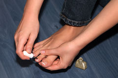 Pedicure. Girl is caring of the feet and toenails Royalty Free Stock Image