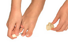 Pedicure. Girl is caring of the feet and toenails Royalty Free Stock Photos