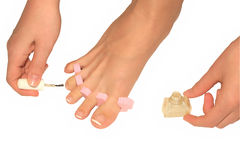 Pedicure. Girl is caring of the feet and toenails using pedicure separators Stock Images