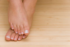 Pedicure. Nice feets on a mat Stock Photography