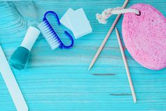 Pedicure accessories with nail polish on wooden background royalty free stock photography