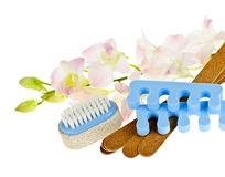 Pedicure accessories and tools. Pedicure accessories with orchid flowers on white background Stock Photos