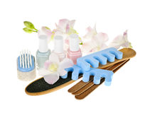 Pedicure accessories and tools. Pedicure accessories and nail polish on white background Royalty Free Stock Image