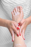 Pedicure applying Stock Photography