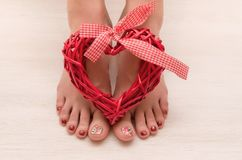 Pedicure of beautiful woman feet. royalty free stock images