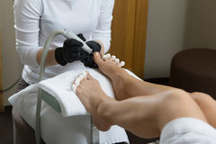Pedicure at the beauty salon nail polish fixative lacquer woman foot Stock Photo