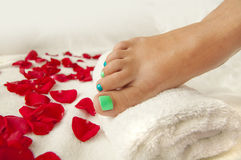 Pedicure in a beauty salon - woman feet ready for treatment Royalty Free Stock Photography