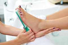 Pedicure dead skin remover feet care woman Stock Photo